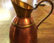 A pretty little Copper and Brass Milk Jug. Stands 11cm to lip.